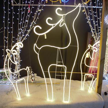 Silueta renos luces de Navidad